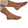 Hand-knitted patterned socks in orange, blue and purple stripy yarn