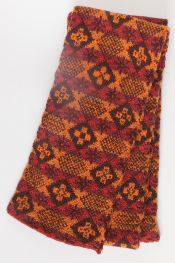 Diced pattern Fair Isle scarf with six cross motifs on darker diamonds and one star motif on lighter diamonds