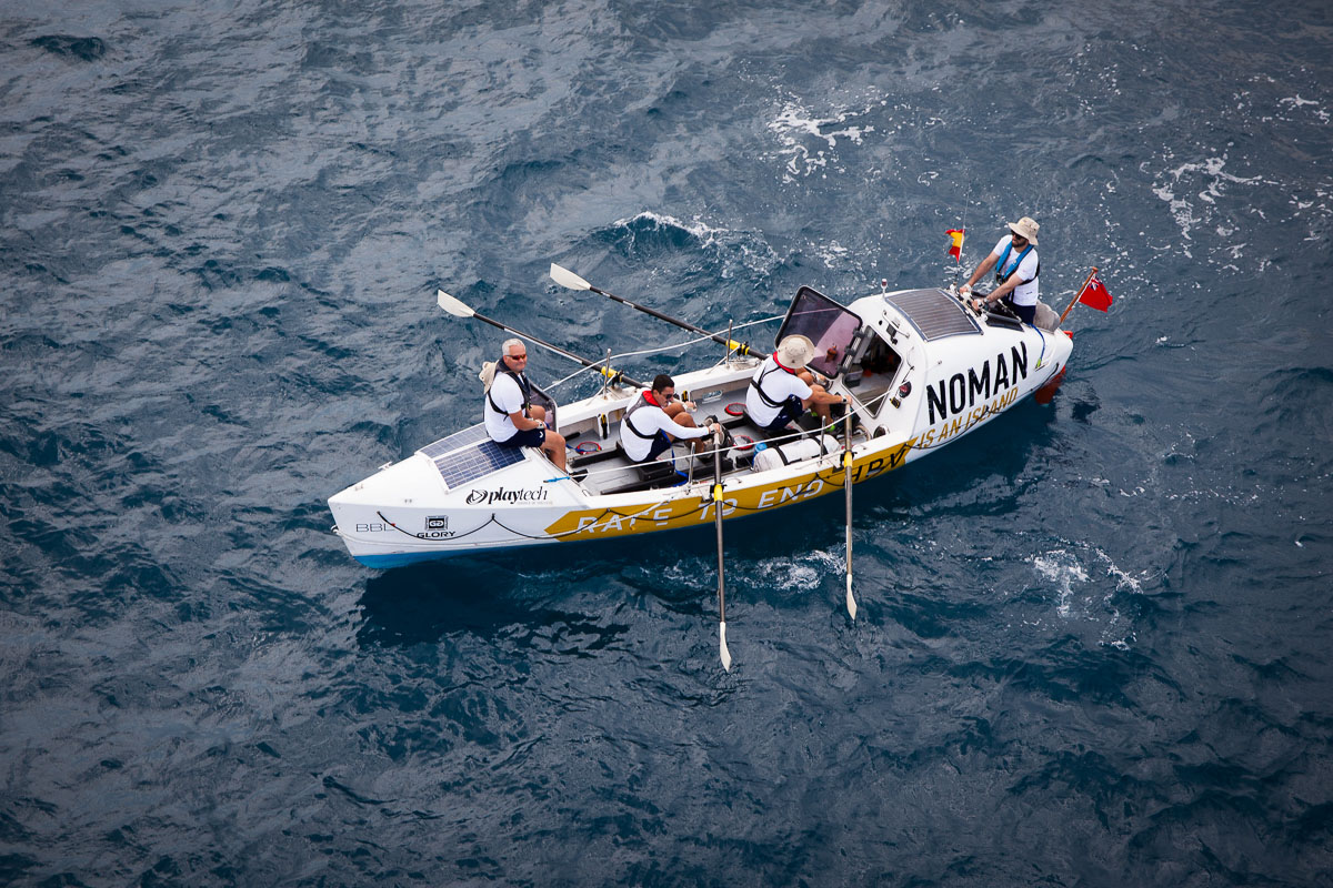 A crew participate in the NOMAN is an Island race to end HPV.