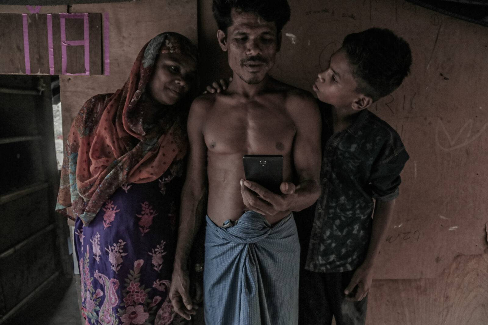 A Rohingya couple with their young son. Their daughter lives in Cox Bazaar, Bangladesh where she got married after she managed to leave Myanmar in 2012.