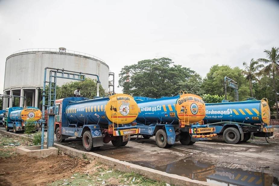A line-up of water tankers in Valluvar Kottam Metro water pumping station, Chennai: Water tankers are mainly used to supply water to apartments, large offices and other bigger buildings for a price. Smaller tanks are used to supply water directly to people. Photo by: Steevez Rodriguez/PEP Collective.