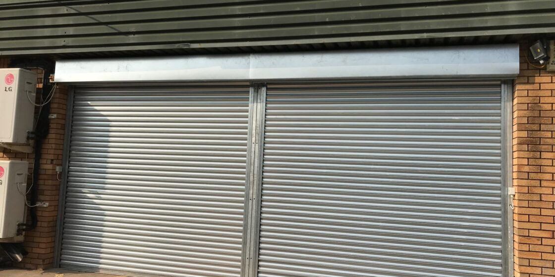 Easy-Roll double commercial automated roller shutter door in silver colour taunton