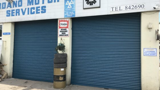 Easy-Roll commercial automated roller shutter door for motor company in blue colour taunton