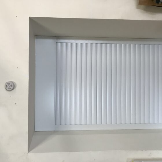 Easy-Roll commercial automated roller shutter door in white taunton