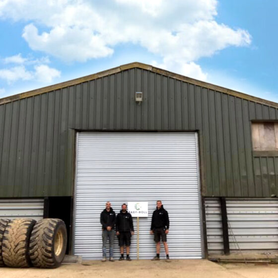 Easy-Roll team photo whilst installing an agricultural roller shutter door