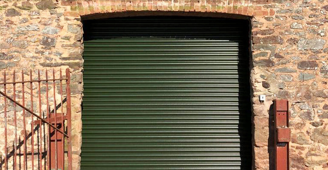 Easy-Roll roller shutter door finished in green
