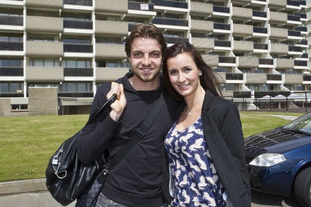 Slide 10 of 15: Tim Krul and his partner Claire at Schiphol Airport where the Dutch soccer players bid farewell to their spouses and partners before they leave for a training camp in Lausanne on May 17, 2012 in Amsterdam, Netherlands. (Photo by VI Images via Getty Images)