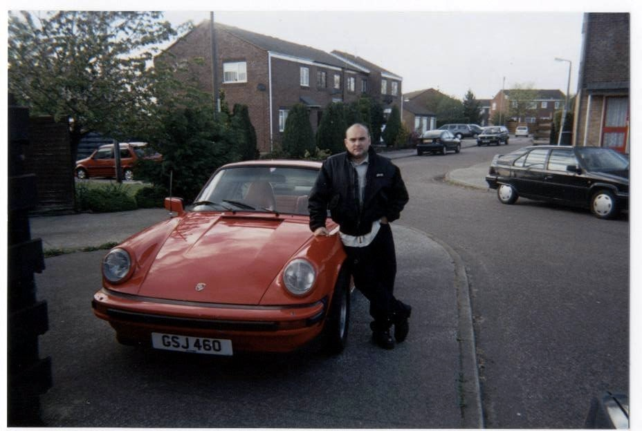 Early 20's.  Who needs hair when you have a 911?