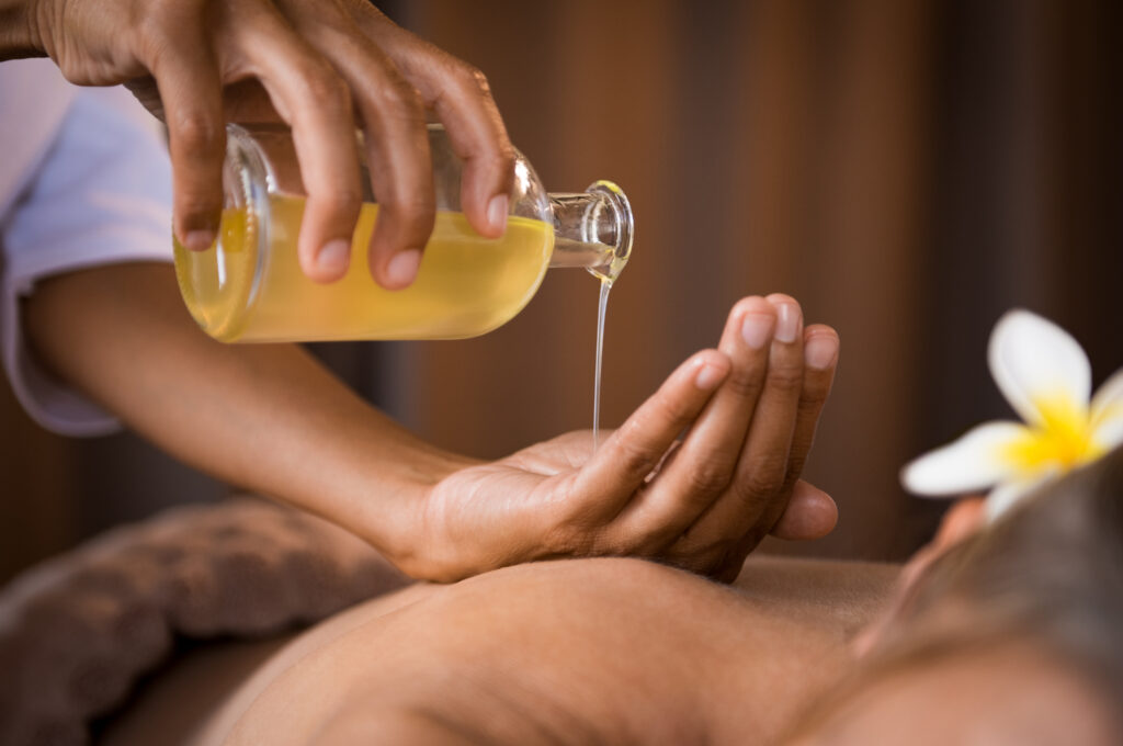 Woman pouring skincare oil into her hand