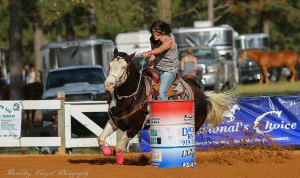 barrel racing cowgirl on paint horse