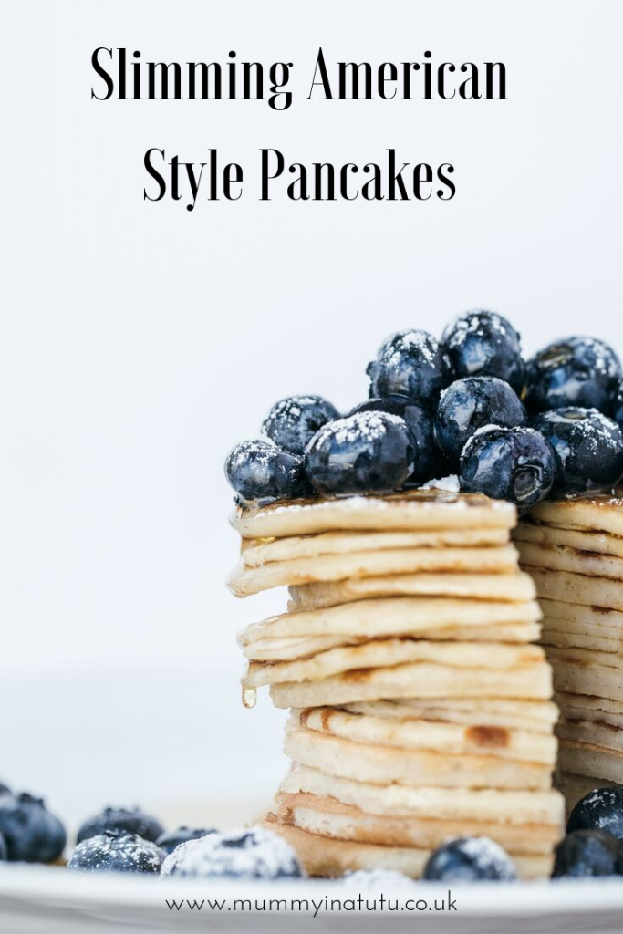 stack of blueberry pancakes with a wedge cut out
