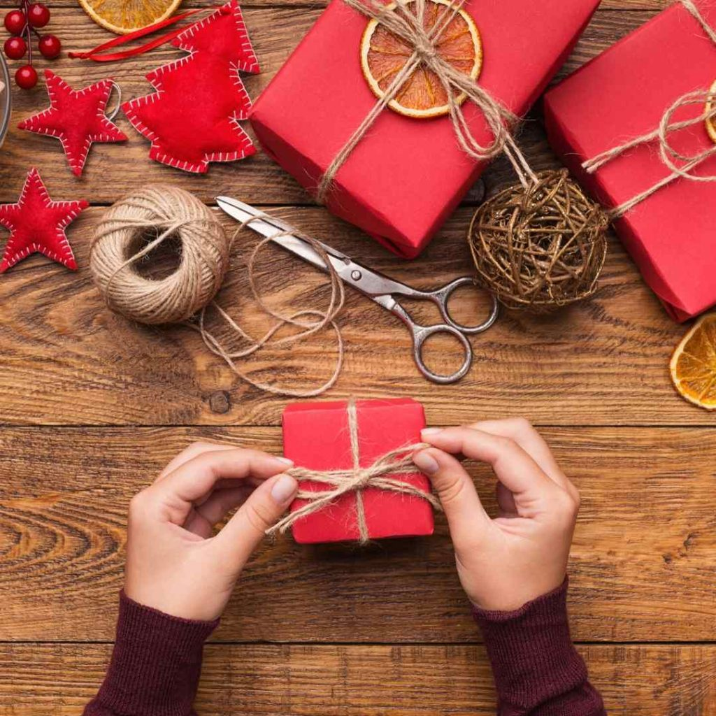 a woman tying a gift with string