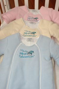 Magic sleepsuit close up of pink blue and yellow fronts