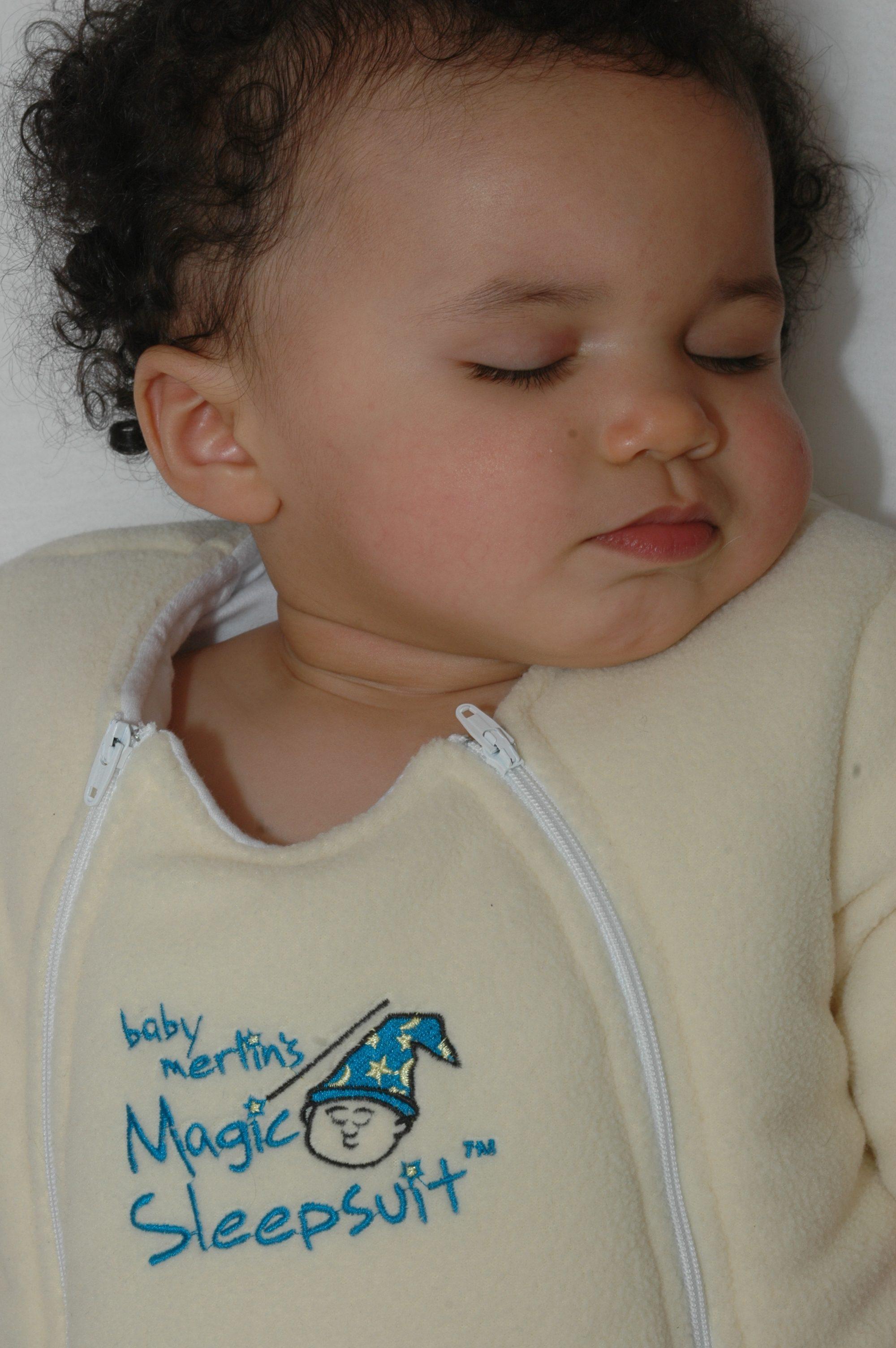 Baby wearing magic sleepsuit lemon colour