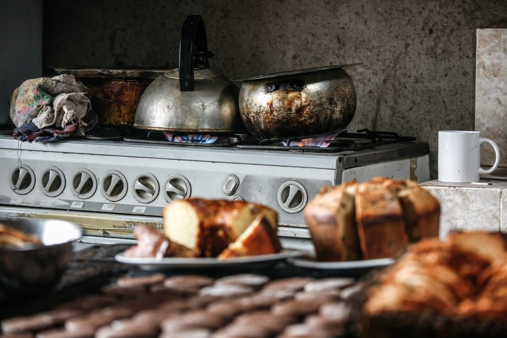 an aga in the background and in the foreground out of focus cakes