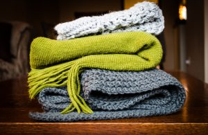 a pile of knitted blankets