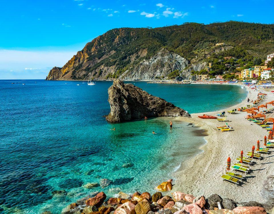 blue sea, coast line, beach, deck chairs, sun