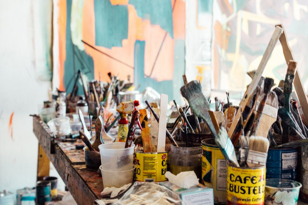 a busy table of tools for DIY