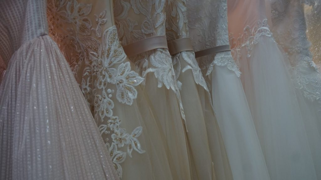 a row of bridal gowns close up