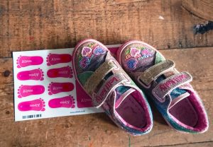 stikets shoe labels in the shape on feet with a pair of pink sparkly shoes