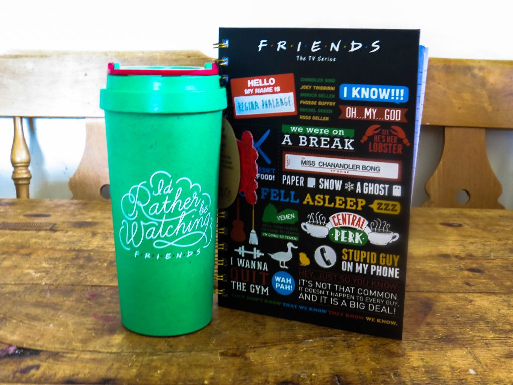 friends green travel mug and notebook