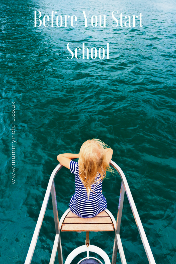 girl looking out over the edge of a boat