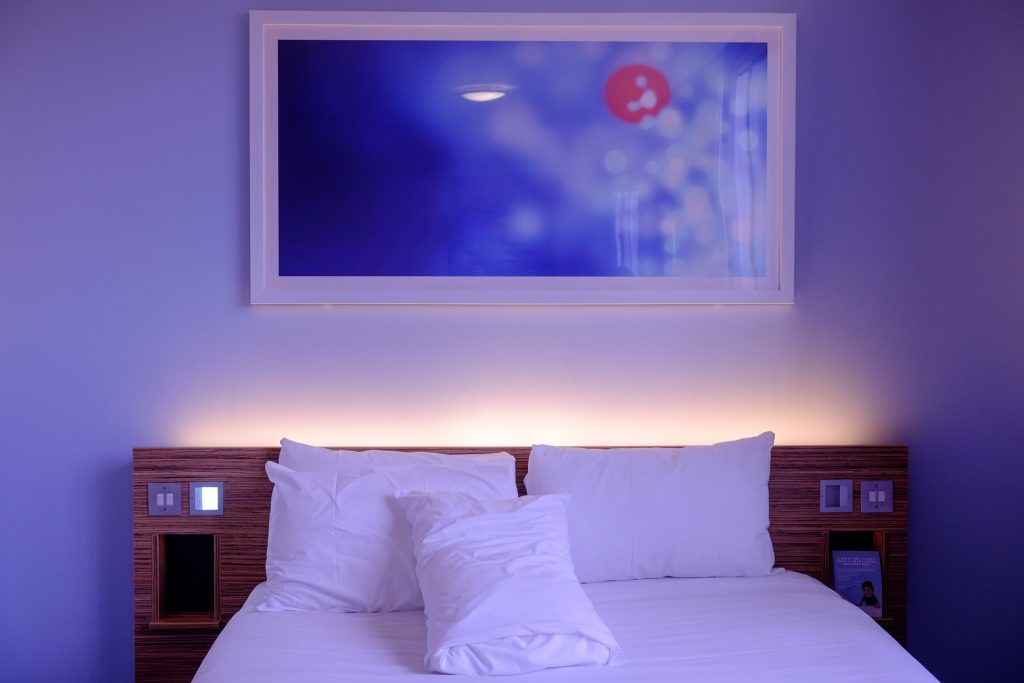 a back lit bed in a hotel