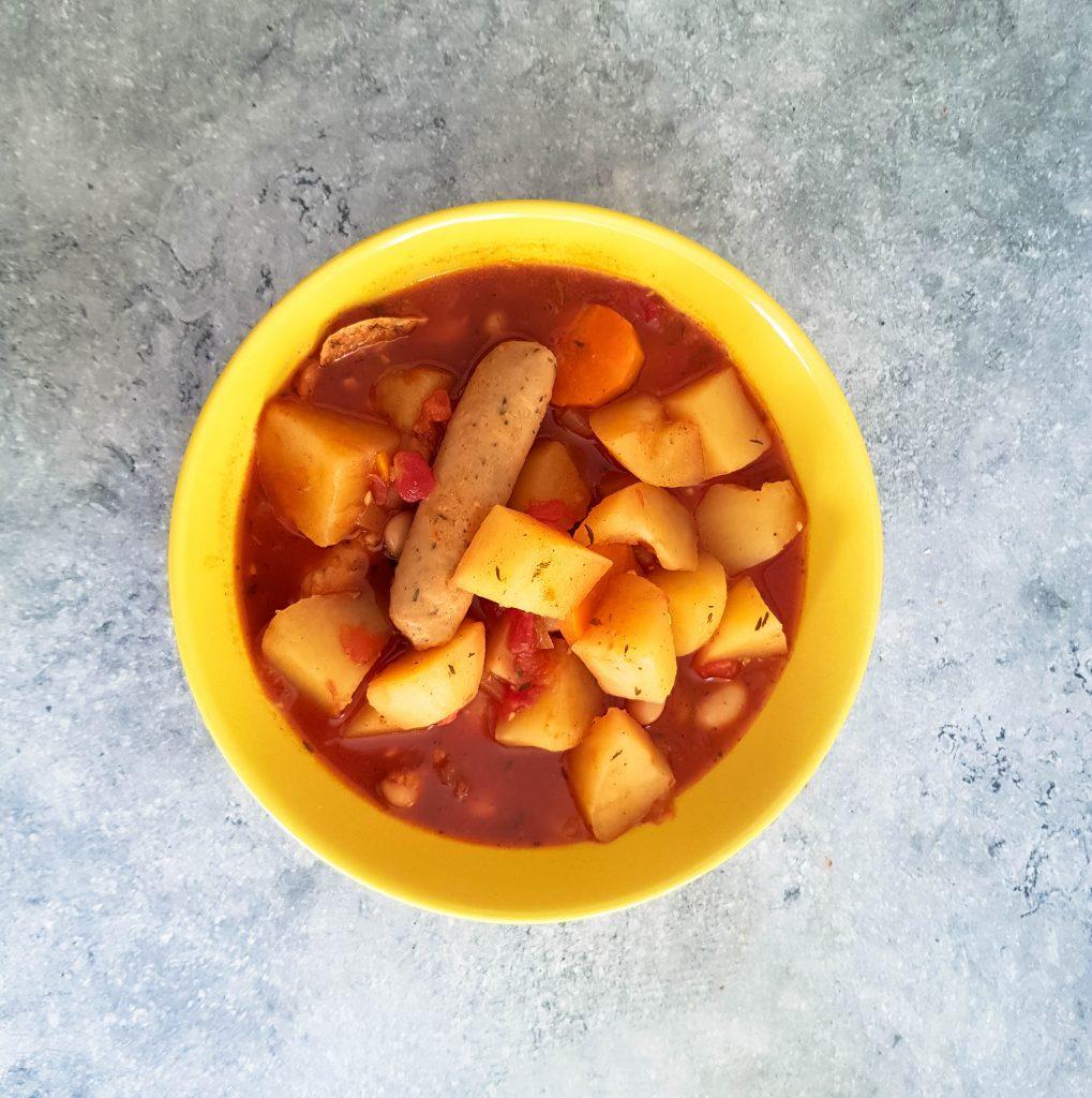 a yellow bowl of sausage casserole