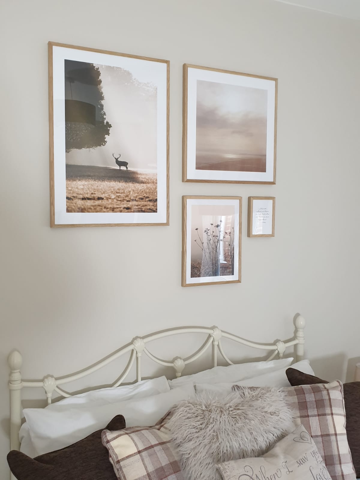 the 4 pictures on the wall above the bed