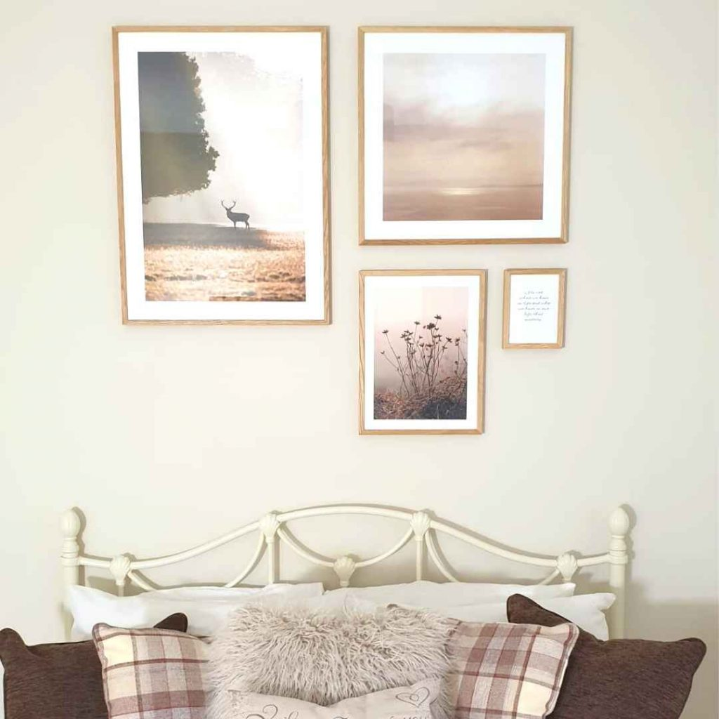 pictures on a wall above a bed