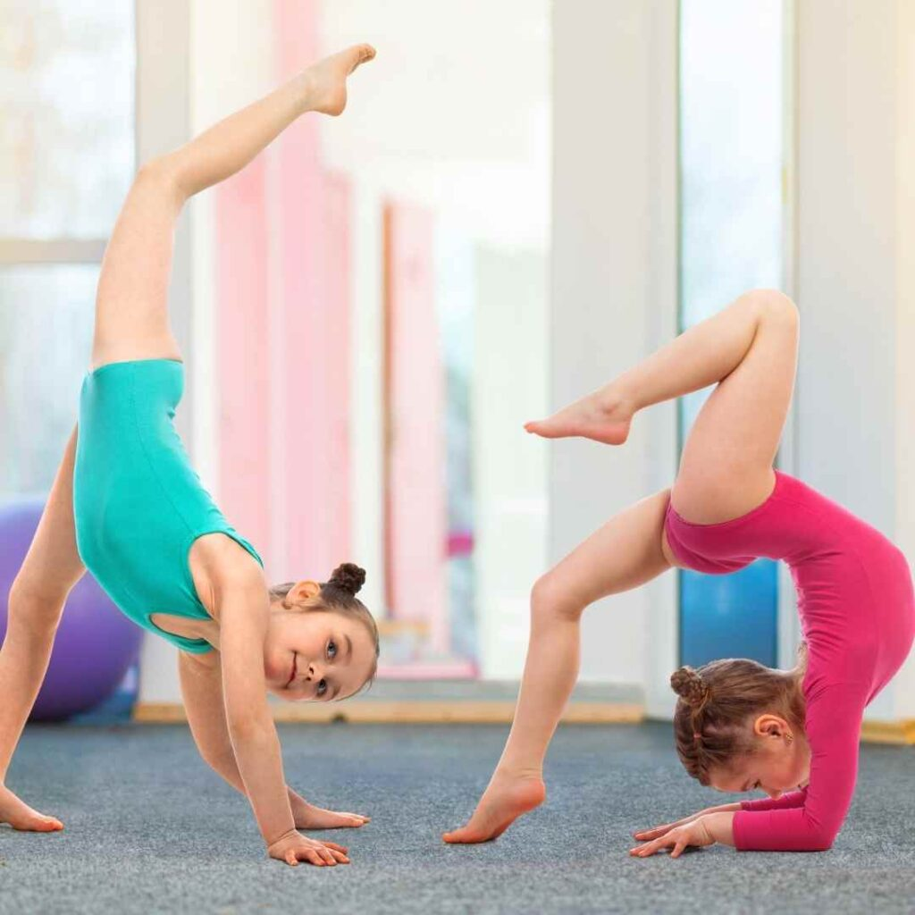 Kids clubs - gymnastics and two kids doing stretches