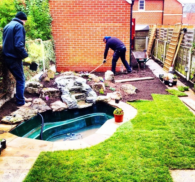 surround a pond with new grass