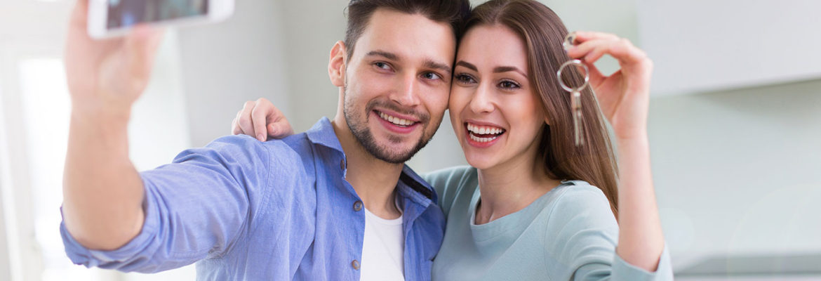 Young couple, taking photo, celebrating new home