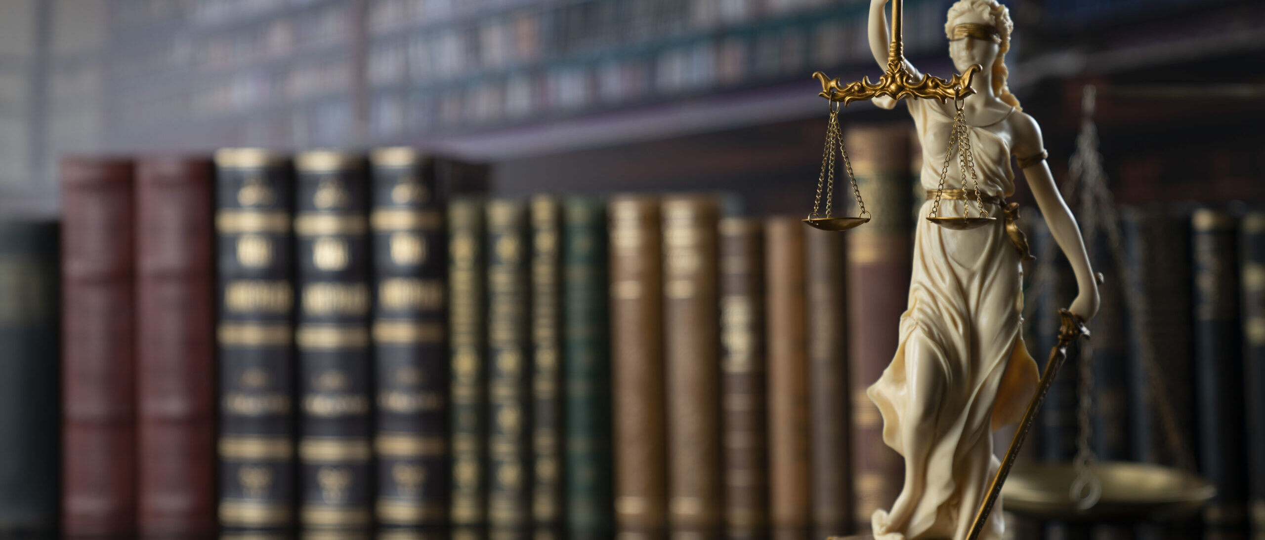 Judge, justice concept background.  Symbol of justice – Themis in the old university library.