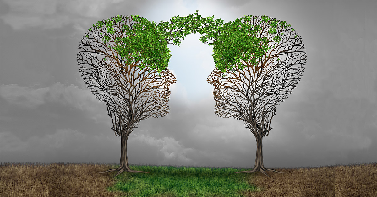 Concept of trees in the shape of heads growing into each other
