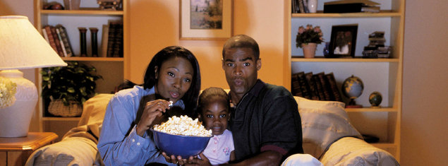 african-family-watching-television