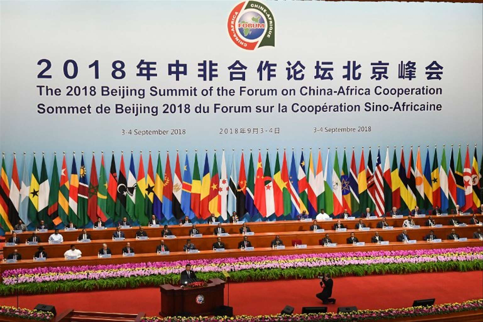 """China's President Xi Jinping (front) gives a speech during the opening ceremony of the Forum on China-Africa Cooperation at the Great Hall of the People in Beijing on September 3, 2018. President Xi Jinping told African leaders on September 3 that China's investments on the continent have """"no political strings attached"""", pledging $60 billion in new development financing, even as Beijing is increasingly criticised over its debt-heavy projects abroad. / AFP PHOTO / POOL / MADOKA IKEGAMI"""