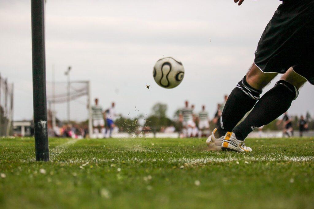 A footballer taking a corner