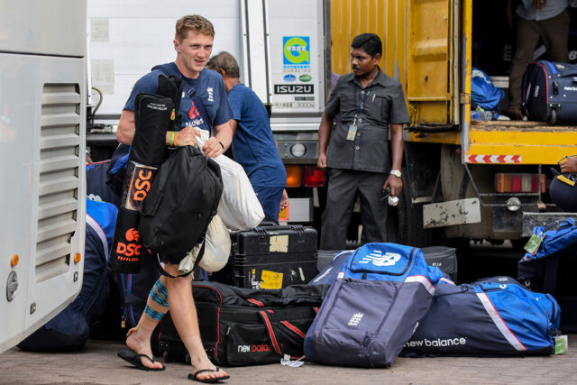England's Dom Bess (L) walks to the bus after the Test series against Sri Lanka was postponed at the P. Sara Oval Cricket Stadium in Colombo on March 13, 2020. - England's cricket team abruptly pulled out of a tour of Sri Lanka on March 13 over the mounting coronavirus pandemic. A practice match in Colombo was halted as the team announced they would be flying back to London, and the first of two Test matches due to start on March 19 has been postponed. (Photo by LAKRUWAN WANNIARACHCHI / AFP) (Photo by LAKRUWAN WANNIARACHCHI/AFP via Getty Images)