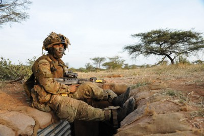 Gurkha soldier taking a rest on top of a trench during an exercise in Kenya