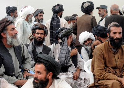 Villagers at the end of a shura between officials and locals