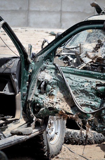 Police truck destroyed by a ballbearing-containing IED