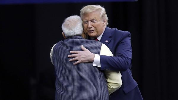 Modi and Trump hug