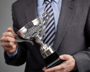 image of man holding award