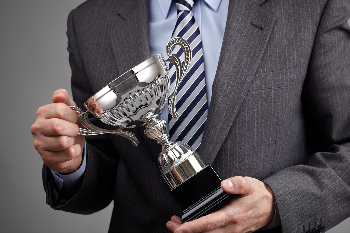 image of man holding award