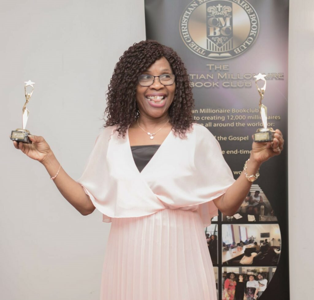 Pastor Esther with awards