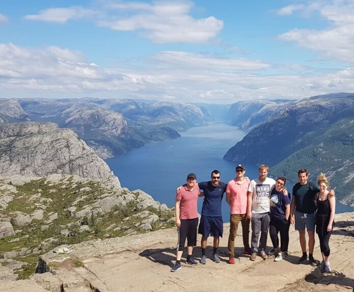 Team photo in front of mountains