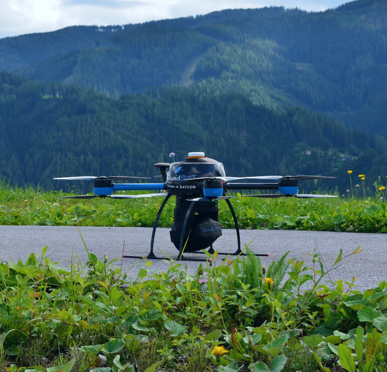 Drone with payload in Aflenz