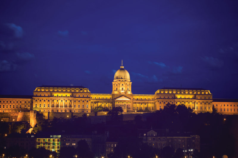 The glittering Parliament building appears to be floating on Danube