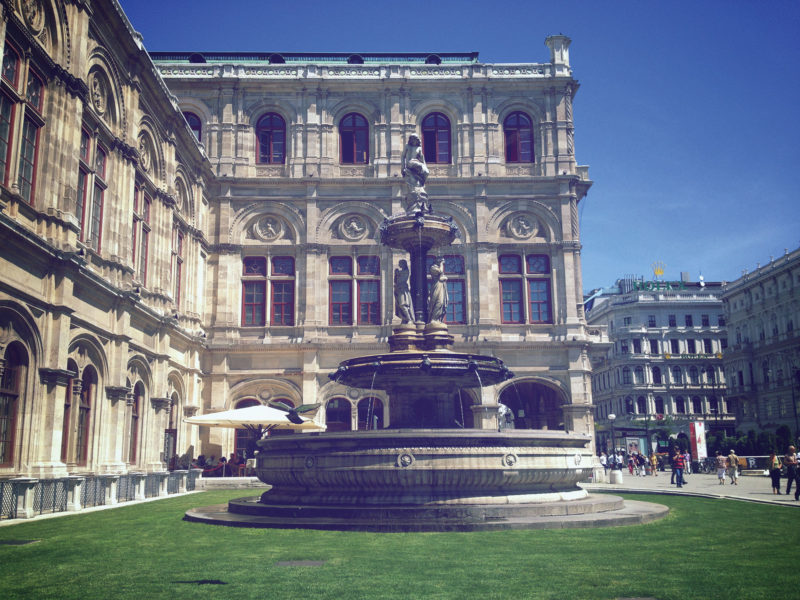 Marble fountain in front of Opera House in Vienna, decorated with a Statue of Lorelei, a siren who sings alluring songs of longing and grief